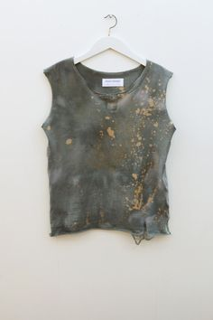 Gold splatter on an old T-Shirt. Actually, the shirt doesn't have to be old.. Just a dark color. Grunge style