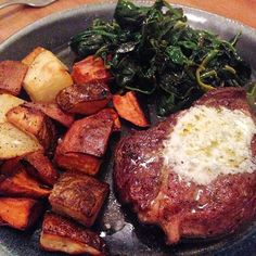 Grassfed boneless rib eye topped with blue cheese butter, roasted potatoes and sweet potatoes, garlicky sautéed spinach #dinner #realfood #yum