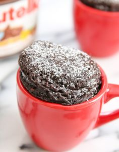 This single serving Nutella mug cake is ridiculously easy to make with just 3 ingredients. It's rich, dense, chocolatey and everything a flourless cake should be.