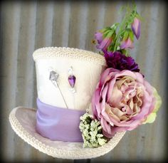 Cream and Purple Easter Mini Top Hat, Flower girl, Tea Party Mini Top Hat, Mad Hatter Hat, Alice in Wonderland. $44.00, via Etsy.