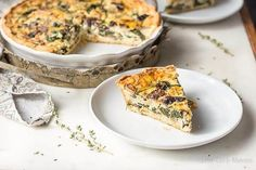 Spinach and mushroom quiche (vegetable quiche) slice on a plate.