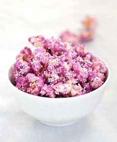 "Very neat idea for a party ""Party Popcorn."" Pop the popcorn, melt white chocolate (can buy it in multiple colors, or add food coloring) and pour over the popcorn, carefully turning it to coat all sides. Use a baking sheet to spread out the popcorn and make this task easier. You can sprinkle with colored nonpareils to add a pizazz."