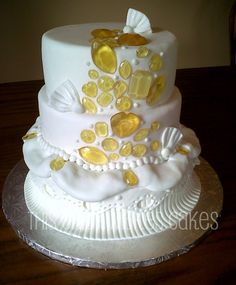 A couture wedding cake with sugar gems and fancy fondant.
