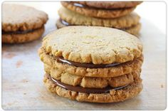 crispy-peanut-butter-cookie-sandwiches-filled-with-peanut-butter-chocolate-ganache @ http://foodporndaily.com