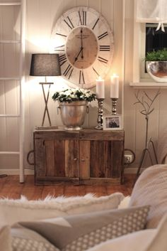 this is fabulous! the rustic cabinet and the huge clock, love it