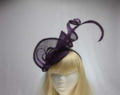 This purple spiral fascinator/cocktail hat is an attention getter!