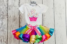 "Baby Girl 1st Birthday Cupcake Shirt w/ Icing ""Sprinkles"" & Rhinestone Age Number-Matches Lollipop Rainbow Satin Ribbon Tutu (No Tutu). $20.00, via Etsy."