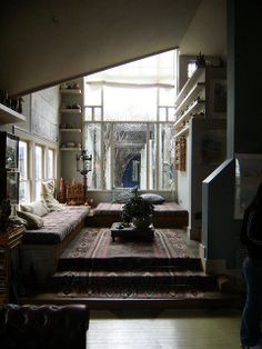 Charles Moore House, Rug carpet leading up the stairs, natural light, calm and peaceful vibes