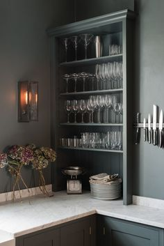 Shallow shelves for glassware - mirror behind?