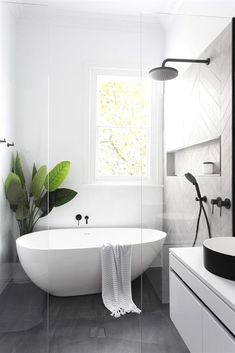 Black and White Bathroom Design . Black and White Bathroom Design . A Contrasting Black and White Bathroom Echoes the Floor