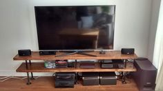 Industrial Pipe and wood TV stand    Media console    Entertainment unit    bookshelf by PipeAndWoodDesigns on Etsy https://www.etsy.com/listing/205082203/industrial-pipe-and-wood-tv-stand-media
