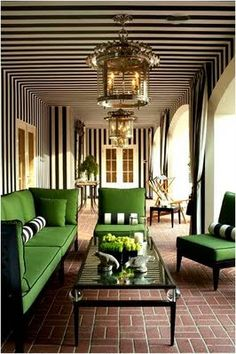 black and white stripes; this is a great way to add drama to a space & modernize it too. I would probably just do the ceiling myself.