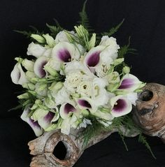Designed with Purple and White Picaso Callas accented with Soft White Lisianthus