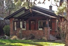 red brick bungalow with dark trim