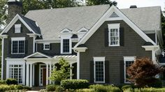 Make your porch pop with a gorgeous exterior color scheme. Get our tips for choosing new paint colors./