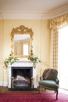 Greenery tumbling down an elegant marble mantel adds an organic element to a formal room.