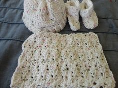 Crocheted baby booties, hat and very soft wash cloth
