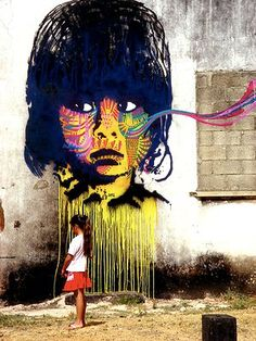 Stinkfish is a Colombian street artist who recreates photographs as street art murals. He makes them into stencils to which he adds multicolored, abstract patterns. - Ms. Vrabie