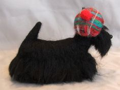 Laurie Valko  Needle felted Scottish Terrier  Scottish Terrier all dressed up in his Donigal Plaid cap. Doesn't he look handsome!