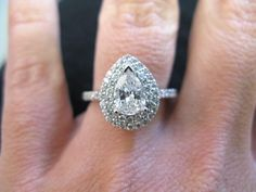 Engagement | The Diamond Shop | St. Louis This custom Thomas Farley beauty is a 14 karat white gold and diamond double halo setting with 34 round diamonds equaling 0.68 ct. Set with a 0.81 ct VS1, E pear shaped diamond. www.thediamondshop.net