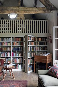This rustic home library has a hidden door. Sold!