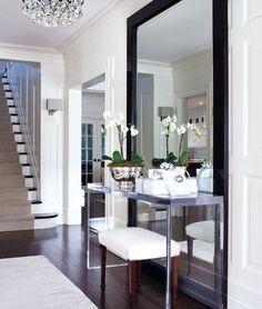 Full length mirror behind a table <3