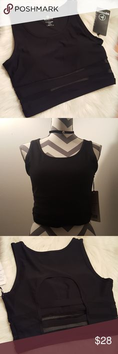 90 degree by Reflex black mesh sports bra sz L NWT. Never been worn. Light padding. Beautiful cut out detail on the back. Mesh detail at the bottom. It has the shape of a sleveless crop top.  SIZE LARGE. True to size. It doesn't have much stretch. It could easily fit Medium. Color: black. 92% polyester, 8% spandex. 90 Degree By Reflex Intimates & Sleepwear Bras