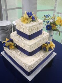 square scroll navy blue wedding cake