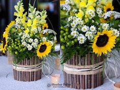 Zukas Hilltop Barn, Spencer, MA Wedding.  Rustic centerpiece with branches and sunflowers.