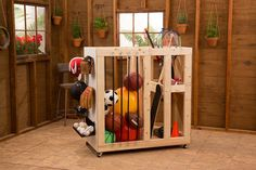 Have an athletic family? Build a rolling sports goods storage cart.