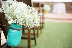 Baby's Breath in Mason Jar for Aisle Decor  Venue - Sassi  Photographer - Terry McKaig #rusticwedding #aisedecor
