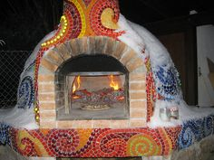 mosaic pizza oven in the snow