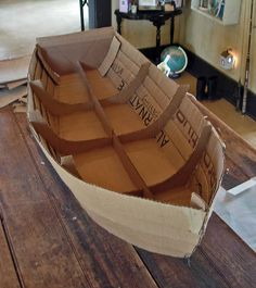 Boat from recycled cardboard and fabric - How perfect for an visual aid when telling Noah and the Ark, Jesus calms the storm, Jonah and the big fish, or any other water-themed Bible story!