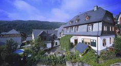 Springiersbacher Hof Ediger-Eller This apartment hotel in Ediger-Eller is set in the former farm estate of an old monastery. It offers great views of the vineyards along the River Moselle, a free outdoor pool, and varied breakfasts.