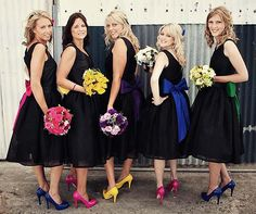 For bridesmaids wearing the same style dress but in different hues, tie their bouquets with ribbons that match their dress color.