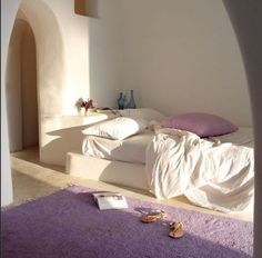 Moroccan inspired earth ship interior in shades of lilac