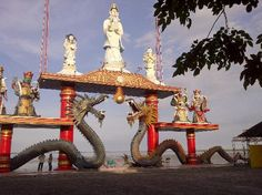 Giant dragon statues surrounded by the sea at Sanggar Agung Temple, Surabaya, Indonesia
