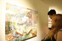 Some of the young professionals who attended were more interested in the art.  Image by Jamie Scott