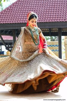 Twirling Brides - Bride in a Copper Mirror Work Lehenga with Red Net Dupatta and an Emerald Long Necklace | WedMeGood #wedmegood #indianbride #indianwedding #twirling #lehenga #bridal #copper #mirrorwork