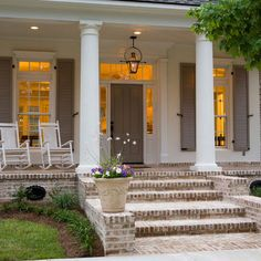 not too many steps up and they are wide (3 steps up would be perfect, I think), like windows on three sides of door (but not going all the way to floor - these are good), lantern, transoms above windows, no railing at front porch/stoop