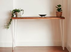 A stylish console table made with reclaimed, recycled wood and mid-century style hairpin legs. This console table will look great in any