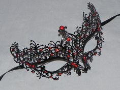 Black Metallic Scroll Filigree Masquerade Mask with Red Accents - Black and Red Metallic Mask by TheCraftyChemist07 (25.95 USD) http://ift.tt/1RtU0Z9