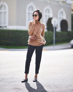 Pin for Later: 38 Outfit Ideas That'll Get You Through Thanksgiving Dinner in Style A Turtleneck Sweater, Tailored Pants, and Loafters.