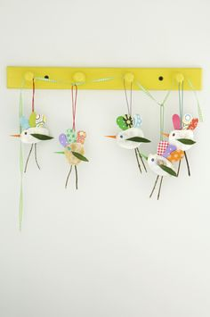Adorable bird mobile made with shells, leaves and twigs