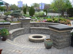brick patio with fire pit design ideas  | ... fire pit , a water feature and an outdoor kitchen. … Retrieve