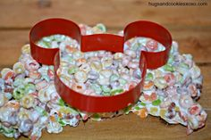 Move over Rice Krispies, there's a new cereal in town that tastes awfully yummy with melted marshmallows! cookie cutter for our froot loops treats
