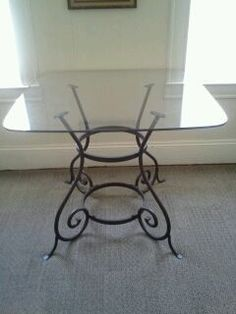 kitchen table with wrought iron base glass top