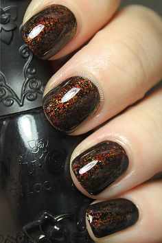 Black Jelly polish with glitter and flakes sandwiched between.
