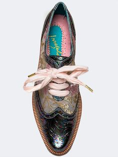 "Never be boring when you've got on these Irregular Choice oxfords! Pointed toe oxford flats have all the style you'll ever want with it's oil slick, iridescent, brogue design and embroirdered sheer mesh upper. This very colorful shoe laces up the front with a frayed ribbon and is complete with a low heel to give you some boost. Non-skid sole and cushioned footbed. Color- Pink Synthetic upper, synthetic sole Measurements approx: Heel 1.25"" Fit: Runs true to size."
