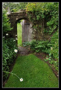 The gate between the Churchyard and the Garden at Great Chalfield Manor, Wilthshire